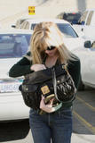 th_57874_RWitherspoon_Butterfly_Candids_13_122_433lo.jpg