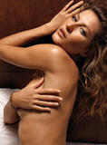 Gisele Bundchen posing nude on bed (covered with sheet) in photoshoot for GQ magazine -